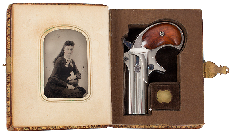 Remington Double Derringer, Cased, 99% Original Finish, 2 Line Address, Elliot Gift to Miss Lilly Woods of Elm Grove West Virginia, Christmas 1876 Includes 2 cartridges, engraved gold shield, tintypes, newspaper clipping Published on cover of The Gun Report Magazine, April 1992, case view 1