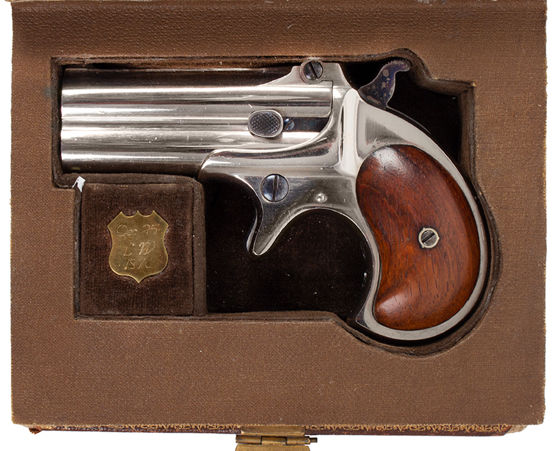 Remington Double Derringer, Cased, 99% Original Finish, 2 Line Address, Elliot Gift to Miss Lilly Woods of Elm Grove West Virginia, Christmas 1876 Includes 2 cartridges, engraved gold shield, tintypes, newspaper clipping Published on cover of The Gun Report Magazine, April 1992, case view 2