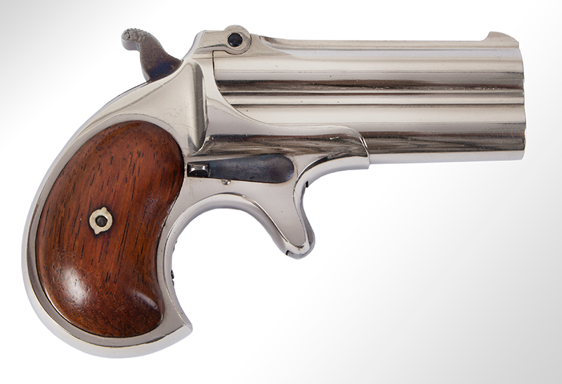 Remington Double Derringer, Cased, 99% Original Finish, 2 Line Address, Elliot Gift to Miss Lilly Woods of Elm Grove West Virginia, Christmas 1876 Includes 2 cartridges, engraved gold shield, tintypes, newspaper clipping Published on cover of The Gun Report Magazine, April 1992, right facing