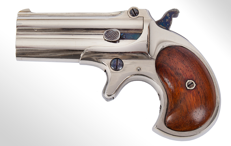 Remington Double Derringer, Cased, 99% Original Finish, 2 Line Address, Elliot Gift to Miss Lilly Woods of Elm Grove West Virginia, Christmas 1876 Includes 2 cartridges, engraved gold shield, tintypes, newspaper clipping Published on cover of The Gun Report Magazine, April 1992, left facing