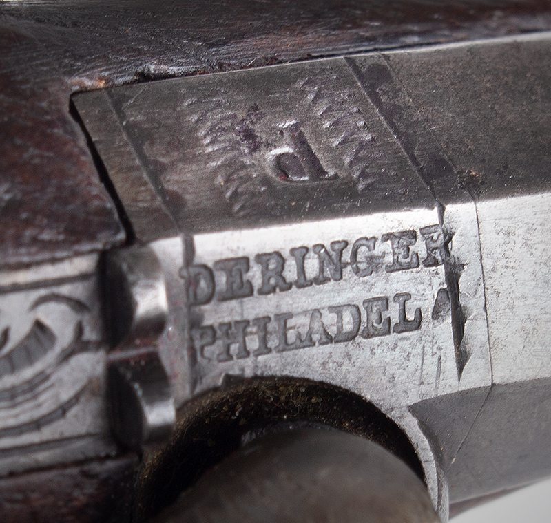 Pistol by Henry Deringer, Silver Mounted, Peanut Size  Deringer – Philadel [sic] Tiny Vest Pocket Size This Henry Deringer Philadelphia tiny vest pocket pistol is a true peanut size,  with a 1-3/8-inch barrel; overall length: 4.25 inches; 41 caliber, serial number 21., detail view