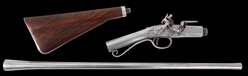 Antique, Breech-Loading Flintlock Poachers Gun, Screw Barrel Take-Down Gun Anonymous, circa 1800-1830 23.75-inch .45-caliber barrel, overall length: 42.5-inches, disassembled