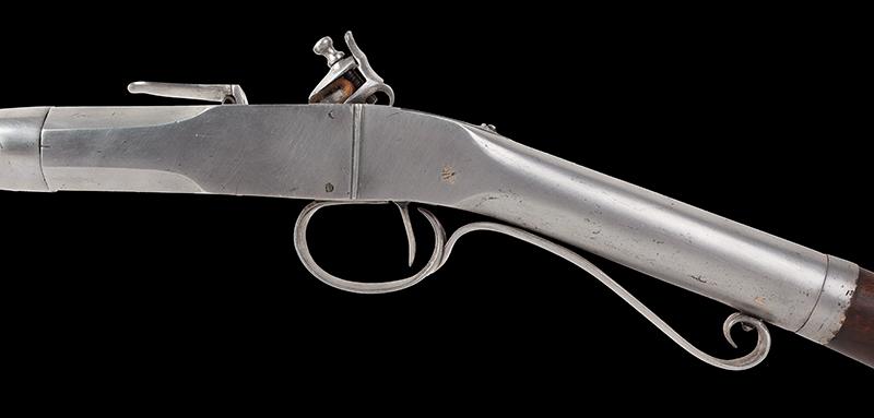 Antique, Breech-Loading Flintlock Poachers Gun, Screw Barrel Take-Down Gun Anonymous, circa 1800-1830 23.75-inch .45-caliber barrel, overall length: 42.5-inches, side plate