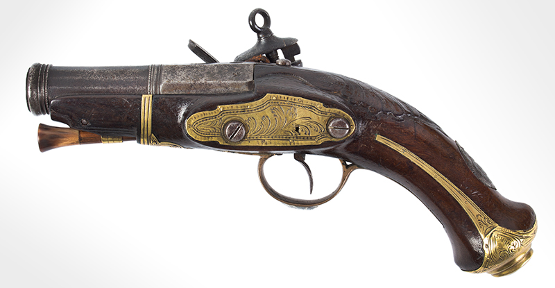 18th Century Spanish Flintlock Pistol, Carved Stock, Miquelet Lock Lock signed: TORENTO, left facing