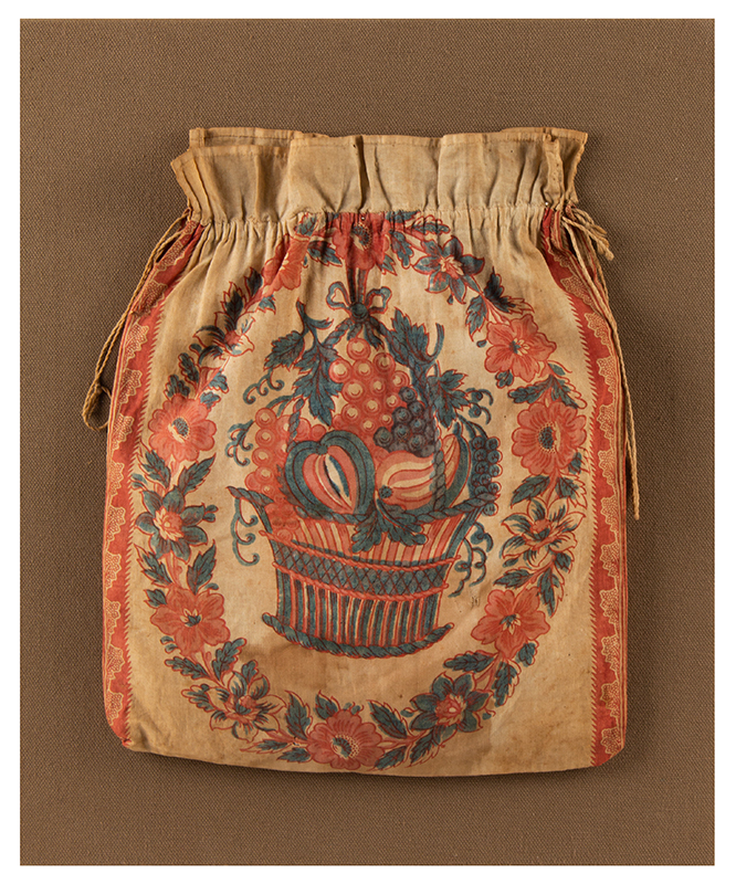 A Period Drawstring Lady's Purse, Reticule, Handbag, Printed Cotton First Quarter 19th Century Reticulated basket of fruits centered by floral garland, entire view