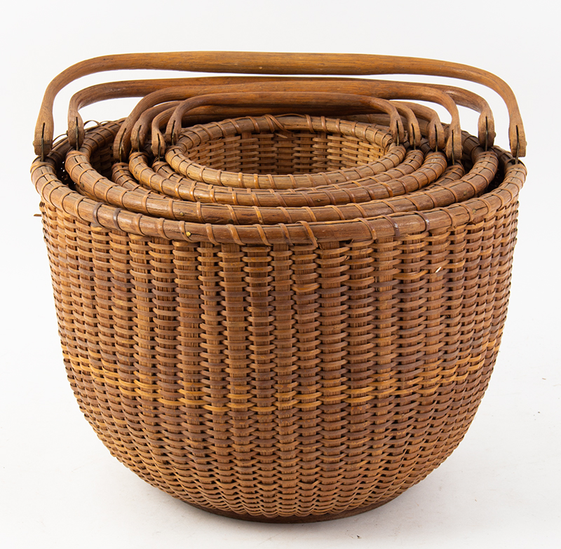 Nantucket Baskets, Nest of Six Nantucket Island, Massachusetts, Early 20th Century A group of six graduated swing-handle lightship baskets, group view 1