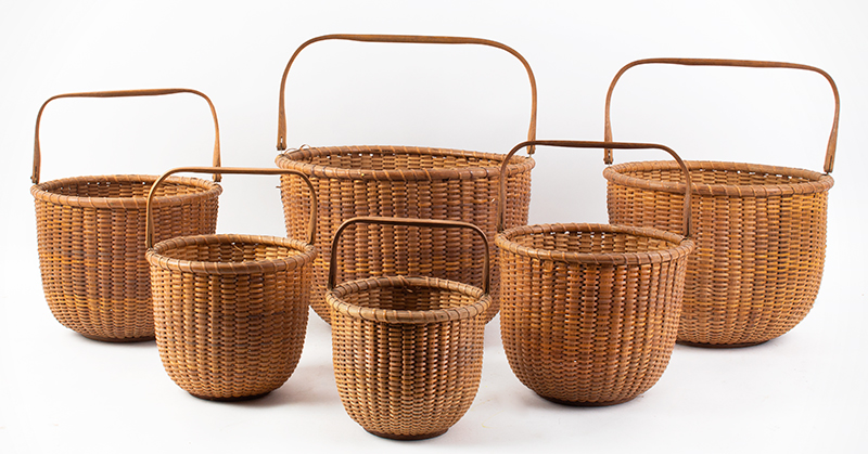 Nantucket Baskets, Nest of Six Nantucket Island, Massachusetts, Early 20th Century A group of six graduated swing-handle lightship baskets, group view 3