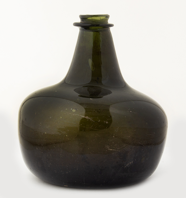 17th Century Transitional Shaft and Globe Bottle England, circa 1680 Classic 6-inch onion form in excellent condition including string rim, entire view