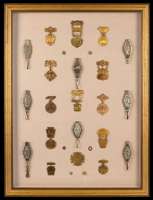 Ornate Framed Lot of Fire Department Cap Holders and Delegate Badges  New York and Pennsylvania Area  Late 19th to early 20th century, entire view