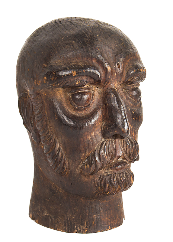 Carved wooden head of a man