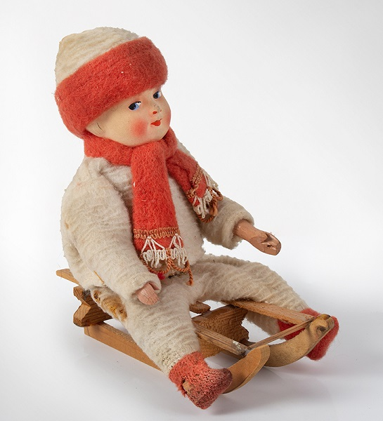 German-Composition-Head-Child-on-Sled, entire view
