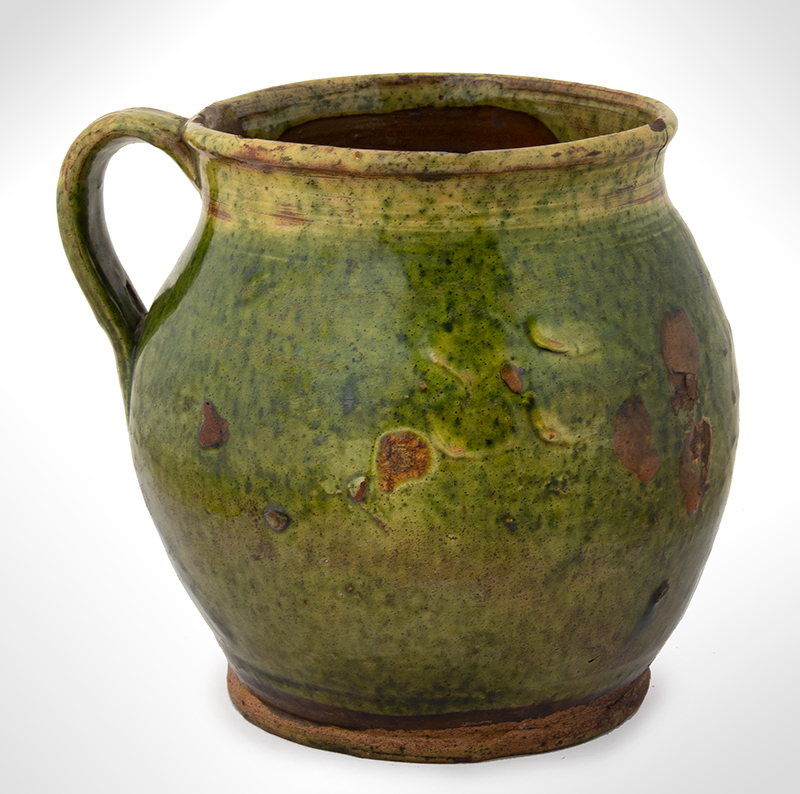 Antique, Redware Ovoid Jug, Copper Oxide Green Glaze Likely French, 1858 Very bulbous, flared rim, a heart centers the date 1858, entire view 2