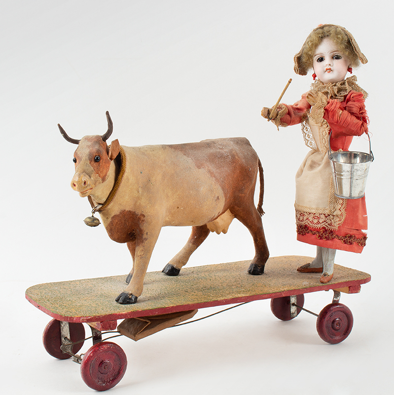 Nodder Cow with Milk Maid on Platform, Pull Toy, entire view