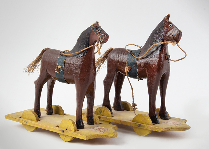3 Miniature tin toys on wheels, entire view