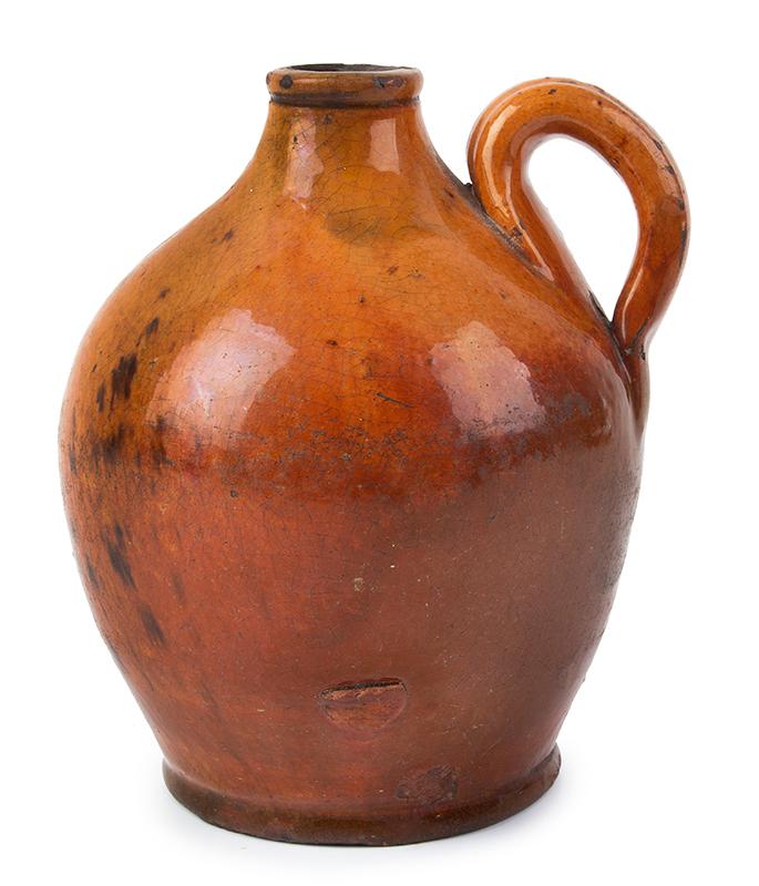 Antique, Small Ovoid Redware Jug Bristol, County, Massachusetts, circa 1790-1820  Bright orange to reddish brown glaze with a tad of green, entire view 2