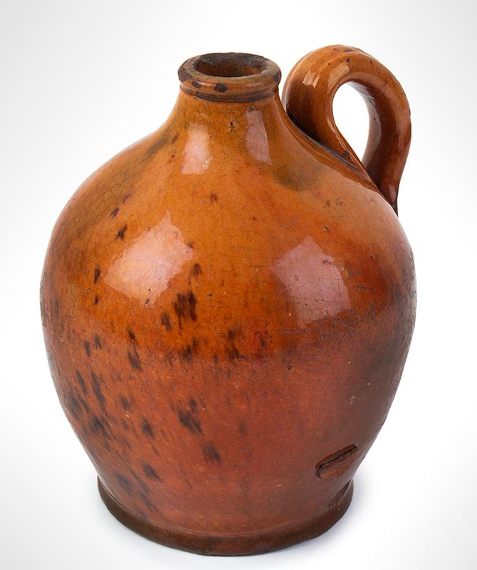 Antique, Small Ovoid Redware Jug Bristol, County, Massachusetts, circa 1790-1820  Bright orange to reddish brown glaze with a tad of green, entire view 3