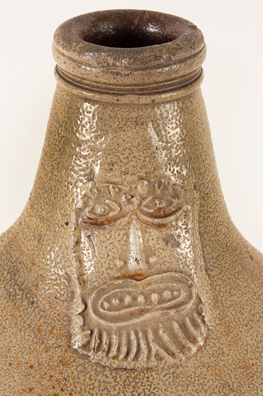 Antique Salt Glazed Stoneware Ovoid Jug, Bellarmine Graybeard  Probably Frechen, Germany, 17th Century Applied mask and three medallions, tooled spout and ribbed handle, neck detail