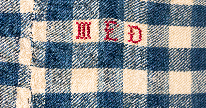 Blanket, Homespun, Blue & White Check, Red Stitched Initials: MED, detail view
