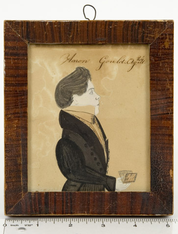 Amos Holbrook, Miniature Portrait of Aaron Gould, Aged 24, New Hampshire, Circa 1830          Portrait of Aaron Gould, small half-length, in a black coat, holding a book Inscribed Aaron            Gould.Ag.d/24 [sic] along the upper edge, ruler view