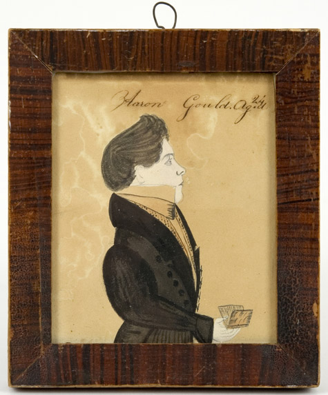 Amos Holbrook, Miniature Portrait of Aaron Gould, Aged 24, New Hampshire, Circa 1830          Portrait of Aaron Gould, small half-length, in a black coat, holding a book Inscribed Aaron            Gould.Ag.d/24 [sic] along the upper edge, entire view