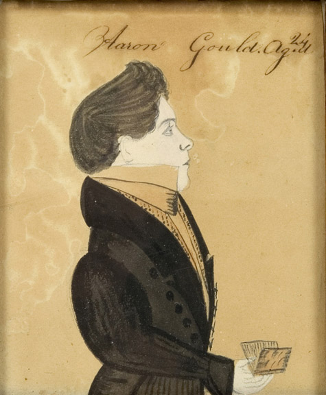 Amos Holbrook, Miniature Portrait of Aaron Gould, Aged 24, New Hampshire, Circa 1830          Portrait of Aaron Gould, small half-length, in a black coat, holding a book Inscribed Aaron            Gould.Ag.d/24 [sic] along the upper edge, sans frame view
