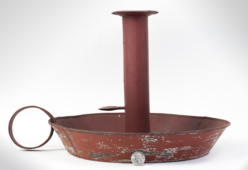 Red Tin Trade Stimulator in form of a Chamberstick, entire view