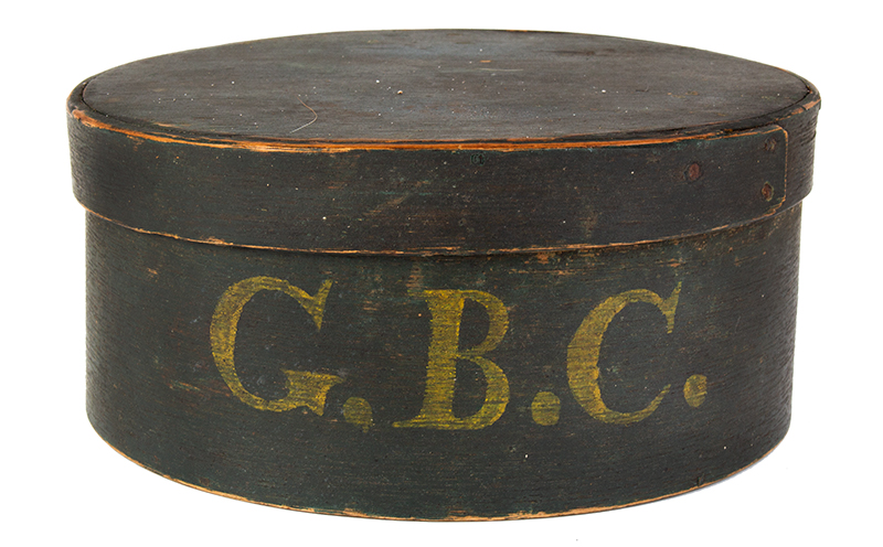 """Tacked Green Round Pantry Box with yellow initials """"GBC"""", entire view"""