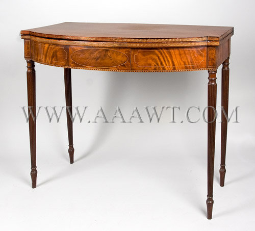 A Fine Inlaid Federal Card-Table Mahogany, elliptical front...blocked ends Probably Portsmouth, New Hampshire Circa 1800-1810, angle view