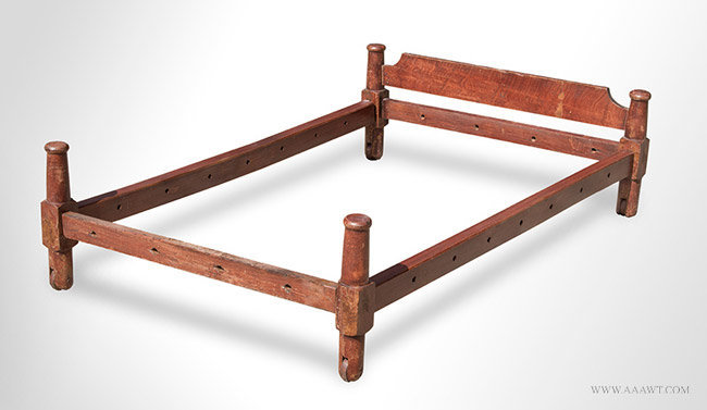 Antique Grain Painted Trundle Bed with Wooden Wheels, New England, 19th Century, angle view