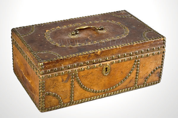 Trunk, Hide Covered, Brass Tack Ornamentation  Wallpapered Interior with Original Maker's Label  Daniel Watson, Saddler, Trunk and Harness Maker  Keene, New Hampshire  Early 19th Century, entire view