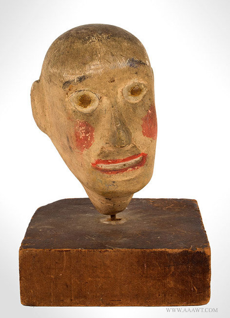 Antique Folk Art Carving of a Head, Painted, angle view 1