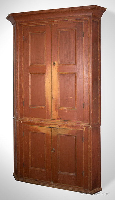 Antique Corner Cupboard in Red Paint with Fielded Panel Doors, Circa 1790 to 1820, angle view