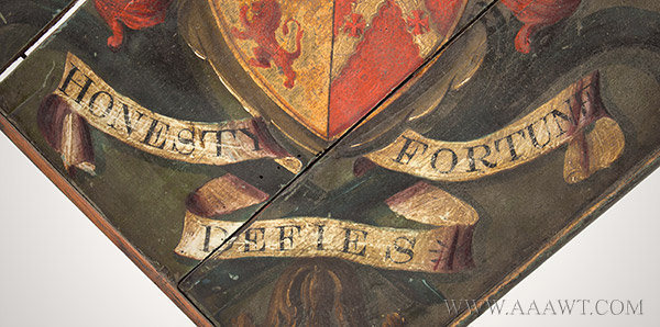 Hatchment, Painted Wood, Bearing Motto, Honesty Defies Fortune  Coat of arms celebrating family distinction and lineage  England, 19th Century, ribbon detail