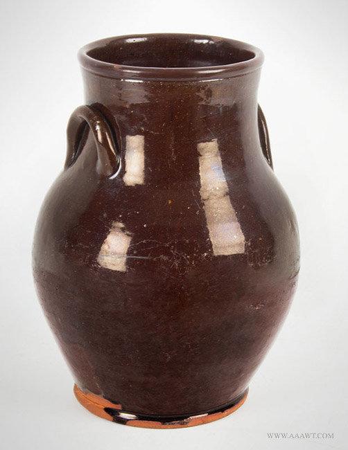 Antique Ovoid Redware Jar with Dark Brown Blaze, 19th Century, angle view