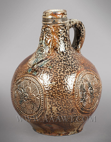 Salt Glazed Stoneware Jug, Dark Brown Tiger Ware, Bartmann, Applied Roundels    Germany    17th Century, angle view 1