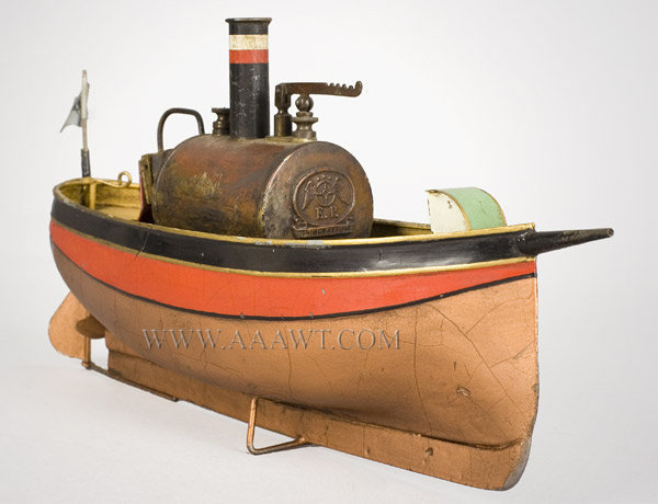 Antique Toy Ship, Steam Powered, With Flag and Burner, front angle view