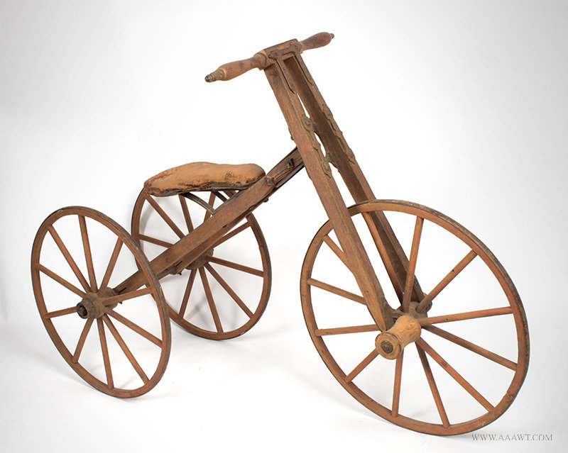 Antique Child's Bone Shaker Tricycle with Wood Frame and Wheels, Circa 1870 to 1880, angle view