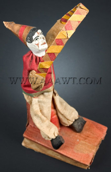 Antique Squeak Toy, Clown with Hoop, angle view