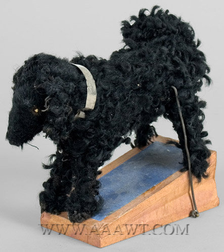 Antique Squeak Toy, Shaggy Black Dog, angle view