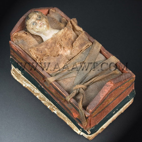 Antique Squeak Toy, Infant in Cradle, Painted, Circa 1830, angle view